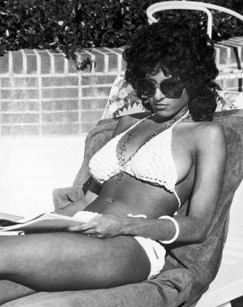 Pam Grier wearing a crochet bikini in Coffy