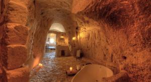 Le Grotte della Civita, Matera, Italy I 7 Cave Hotels to Get Cozy In This Fall