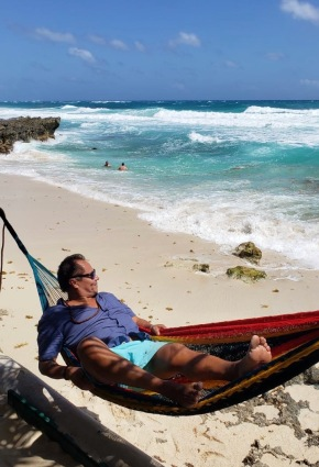 Alberto living his best hammock life. At The Liquor Box, Cozumel, Mexico